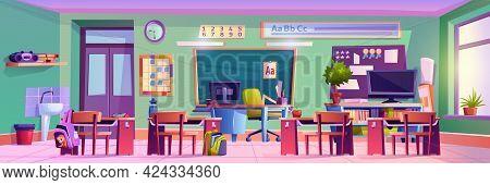 Empty Classroom In Elementary School, Interior Of Room With Chalkboard, Desks With Personal Belongin