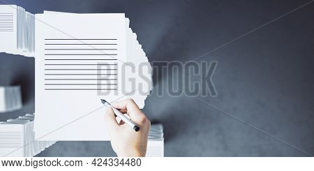 Top View Of Hand With Paperwork Stack On Concrete Background With Mock Up Place. Workload And Bureau