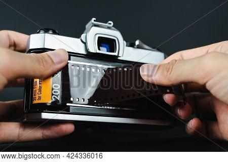 Photographer Hand Loading 35Mm Film Into Slr Film Camera. .