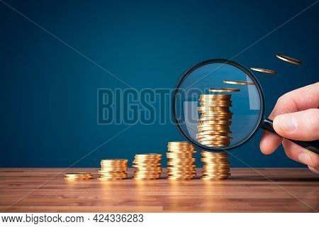 Inflation, Tax, Cash Flow And Another Financial Concept. Financial Advisor Focused On Decreasing Val