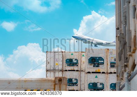 Cargo Airplane Flying Above Logistic Container. Air Logistic. Reefer For Frozen Food. Refrigerated C