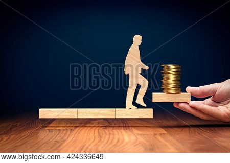 Personal Development Leads To Higher Earnings. Motivational Financial Concept With Wooden Person And