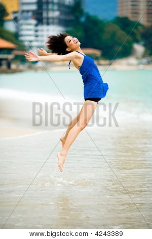 Beautiful Asian Woman At The Beach