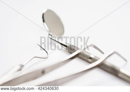 Basic Dentist Tools In Clinic On White Background.