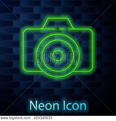 Glowing Neon Line Photo Camera Icon Isolated On Brick Wall Background. Foto Camera Icon. Vector Illu