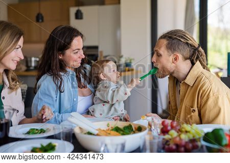 Happy Multigeneration Family Indoors At Home Eating Healthy Lunch.