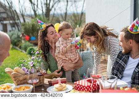 Happy Multigeneration Family Outdoors In Garden At Home, Birthday Celebration Party.