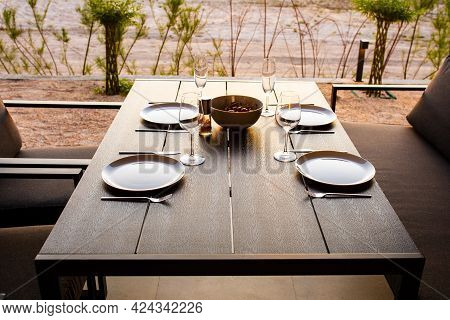 Laid Table For Four On The Summer Terrace. Summer Terrace For Friends. Dinner On The Terrace. Table
