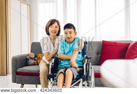 Portrait Of Enjoy Happy Love Family Asian Mother Playing And Carer Helping Look At Disabled Son Chil