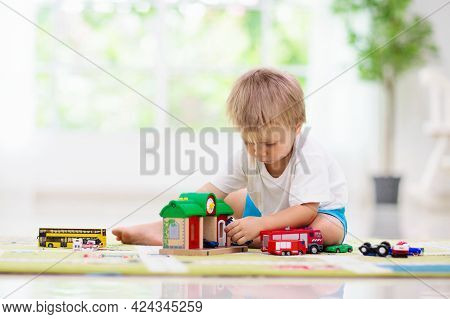 Little Boy Playing Toy Cars On Play Mat. Young Kid With Colorful Educational Vehicle And Transport T