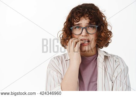 Anxious Girl Student In Glasses, Woman Biting Fingernails And Looking Up Nervous, Feeling Worried As