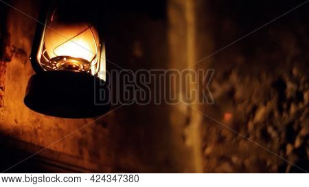 Hand Taking Old Fashioned Hanging Street Lamp Outdoors. Video. Dark Scary Street With A Retro Street