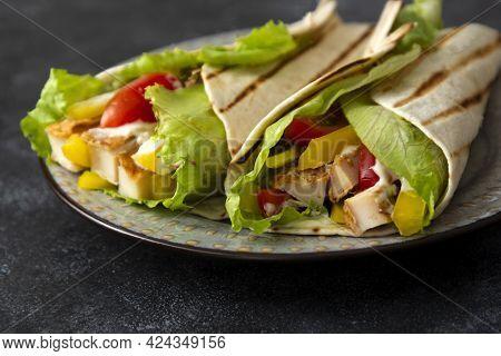 Chicken Wrap Sandwich With Fresh Vegetables. Delicious Healthy Food Over Dark Background