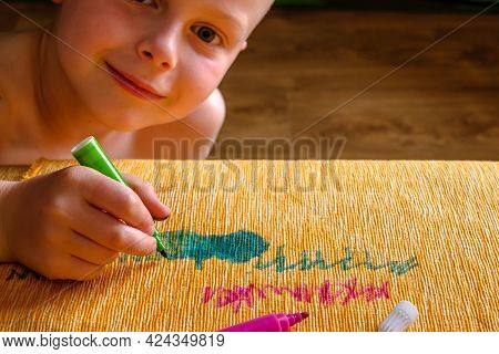 The Boy Drawing With Green Felt-tip Pens On The Fabric Of The Couch. Daily Life Dirty Stain For Wash