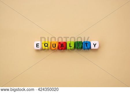 Equality Word Text Made From Colorful Wooden Cubes. Inclusive And Tolerance Social Concept.