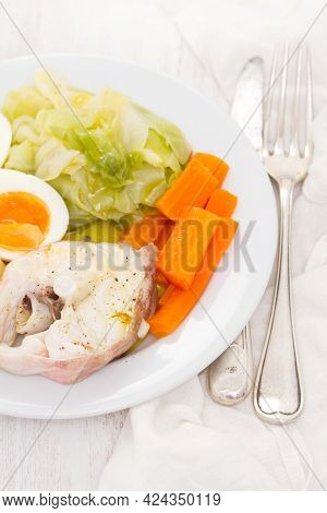 Boiled Fish With Boiled Vegetabbles On White Plate