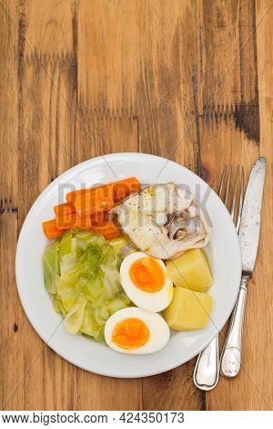 Boiled Fish With Boiled Vegetables On White Plate