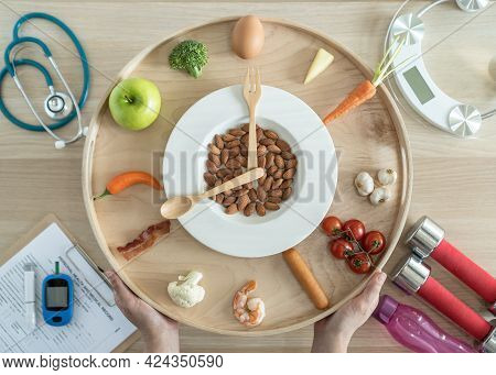 Intermittent Fasting If And Keto Diet Concept With Hour Clock Timer For Skipping Meal, Eating Ketoge