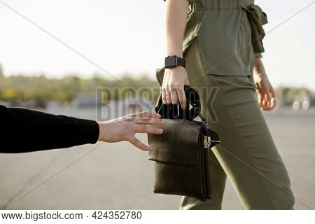 A Young Woman Walking In The City Street And Burglar Try To Steal Her Bag, Criminal And Violence Con