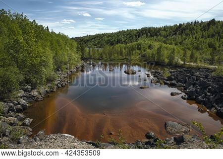 Small Sandy Lake In Boreal Forest On A Sunny Day