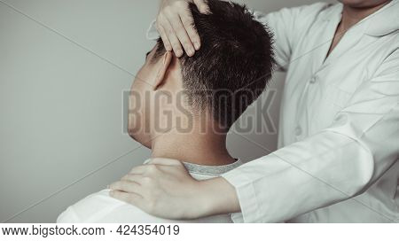 Physical Therapy, Female Physiotherapist Examined The Neck Injuries Of A Male Patient Attending The