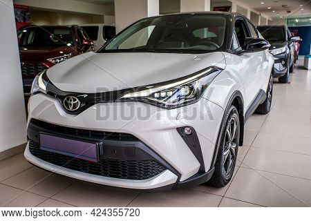 Uzhhorod, Ukraine. March 2021, A White Car Of The Japanese Brand Toyota C-hr. Reliable And Beautiful