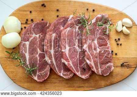 Fresh Meat Steaks With Spices Om Wooden Cutting Board Ready To Cook