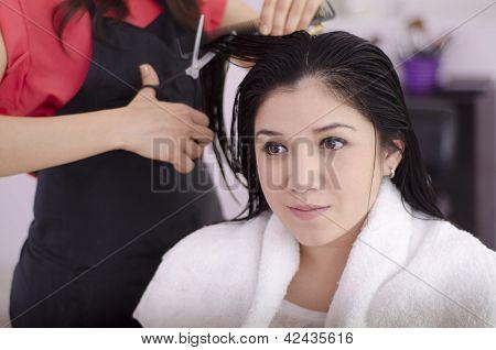 Cute girl getting a haircut