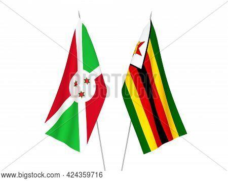 National Fabric Flags Of Zimbabwe And Burundi Isolated On White Background. 3d Rendering Illustratio