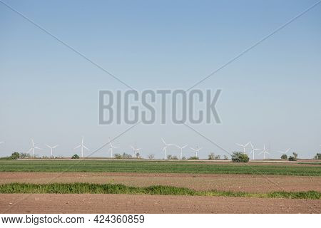 Landscape Of Voivodina, In Serbia, With Blurred Windmills In The Background. This Windfarm, Made Of