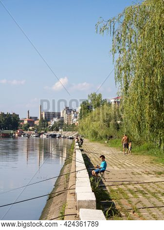 Pancevo, Serbia - July 30 2016: Young Child, Boy, Fishing On Tamis River, On Pancevo Waterfront, Dur