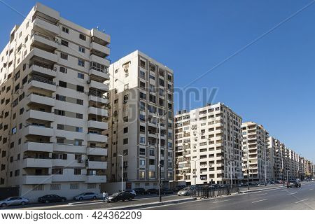Street Of Hurghada City In Egypt. Residential Buildings In The Same Architectural Style In A Residen