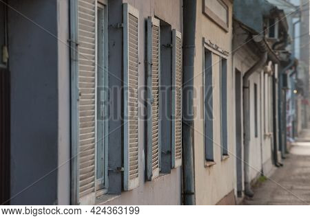 Selective Blur On Wooden Blinds And Blinders On Windows On The Ground Floor Of A House, A Residentia