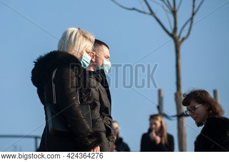 Belgrade, Serbia - March 13, 2021: Selective Blur On A Man And Woman, Couple, Lovers, Wearing A Face