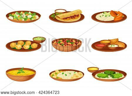 Dishes And Main Courses Of Indian Cuisine With Rice, Mixed Vegetables And Served On Plates And Garni