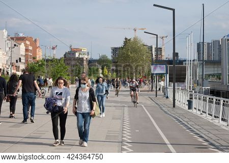 Belgrade, Serbia - May 3, 2021: Two Young Women, One Wearing A Face Mask, The Other Not Wearing A Fa