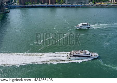 Aerial View On Of Circle Line Sightseeing Cruises With A Boat Around Manhattan Island With A Boat In