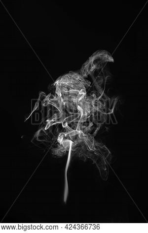 Close_up White Smoke On A Black Background.