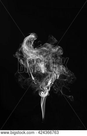 The White Smoke On A Black Background.