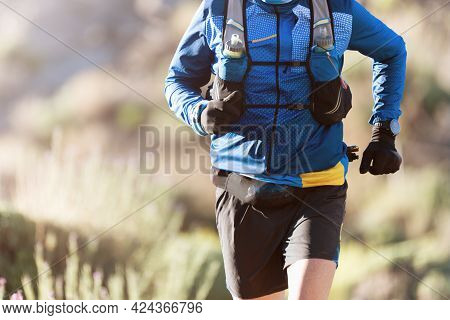 Male Athlete Run Mountain Race Wth Hydratation Trail Vest For Running