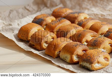 Homemade Buns With Fruit Jam On A Background Of Crumpled Pastry Paper. Selective Focus. Close-up.