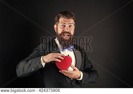 Amazed Tuxedo Man With Beard Hold Romantic Love Heart, Happy Valentines Day