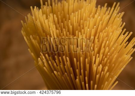 Dry Spaghetti On Wooden Background Ingredient, Uncooked