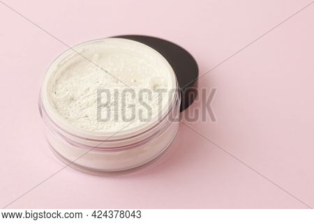 Loose White Face Powder On A Delicate Background. Professional Cosmetics