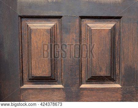 Part Of A Massive Vintage Wooden Door. Brown Wood Texture Background