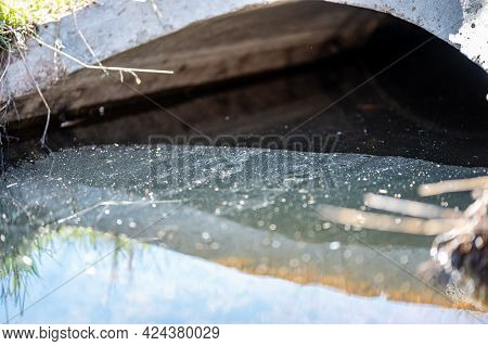 Full Capacity Concrete Culvert With Sheen Contaminated Storm Water Runoff