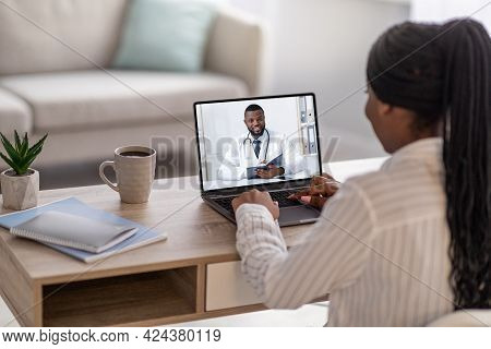 Back View Of Black Woman Having Online Appointment With Doctor