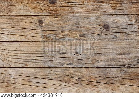 Old Brown Wood Background Made Of Dark Natural Wood In Grunge Style. The View From The Top. Natural