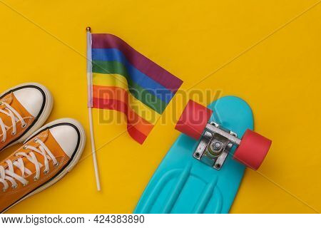 Lgbt Rainbow Flag And Sneakers, Cruiser Board On Yellow Background. Tolerance, Freedom, Gay Parade
