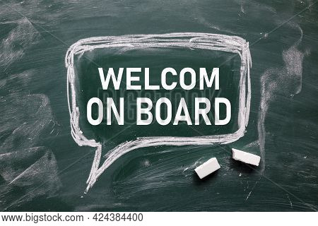 Welcome Aboard. Text On White Paper On Chalkboard